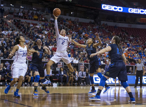 Boise State Broncos forward Shalen Shaw (2) lay up the ball through the Nevada defense during second quarter of an NCAA college basketball game in the championship of the Mountain West Conference tournament Friday, March 9, 2018, in Las Vegas. (AP Photo/L.E. Baskow)
