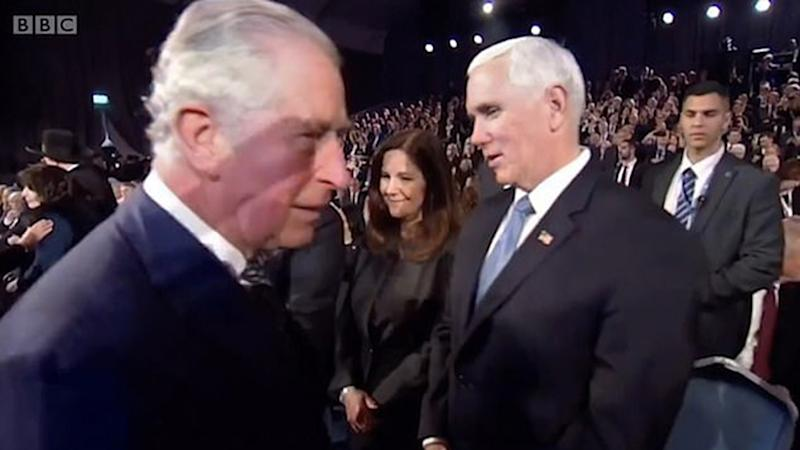 Prince Charles (left) passes vice president Mike Pence and wife Karen Pence at Yad Vashem
