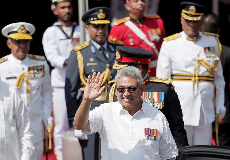 Sri Lanka's President Rajapaksa waves during the 72nd independence day ceremony, in Colombo