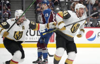 Vegas Golden Knights right wing Reilly Smith, left, celebrates with center Jonathan Marchessault, who scored the tying goal against the Colorado Avalanche during the third period of Game 5 of an NHL hockey Stanley Cup second-round playoff series Tuesday, June 8, 2021, in Denver. (AP Photo/David Zalubowski)