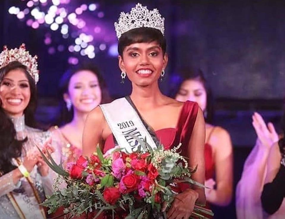 She was crowned Miss Universe Singapore on 17th October 2019, at Zouk, Singapore, and would be representing the country at the Miss Universe pageant this year. The 24-year-old beauty with a distinct pixie-cut holds a degree in biomedical science.