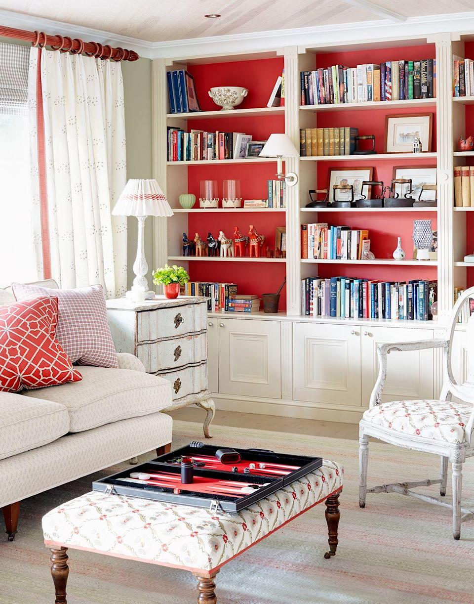 <p>If you love nothing more than making a statement, paint the back of your bookcases in a daring shade to show off your every-growing collection. </p>