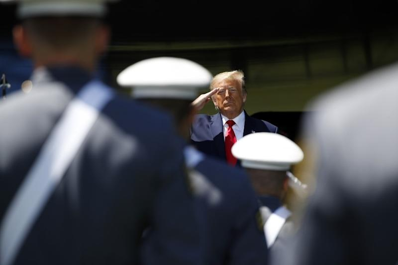 President Donald Trump salutes after speaking to over 1,110 cadets in the Class of 2020 at a commencement ceremony on the parade field, at the United States Military Academy in West Point, N.Y., Saturday, June 13, 2020. (AP Photo/Alex Brandon)