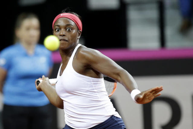 Sloane Stephens of USA returns the ball to Pauline Parmentier of France during the Fed Cup semifinal singles tennis match in Aix-en-Provence, southern France, Saturday, April 21, 2018. (AP Photo/Claude Paris)