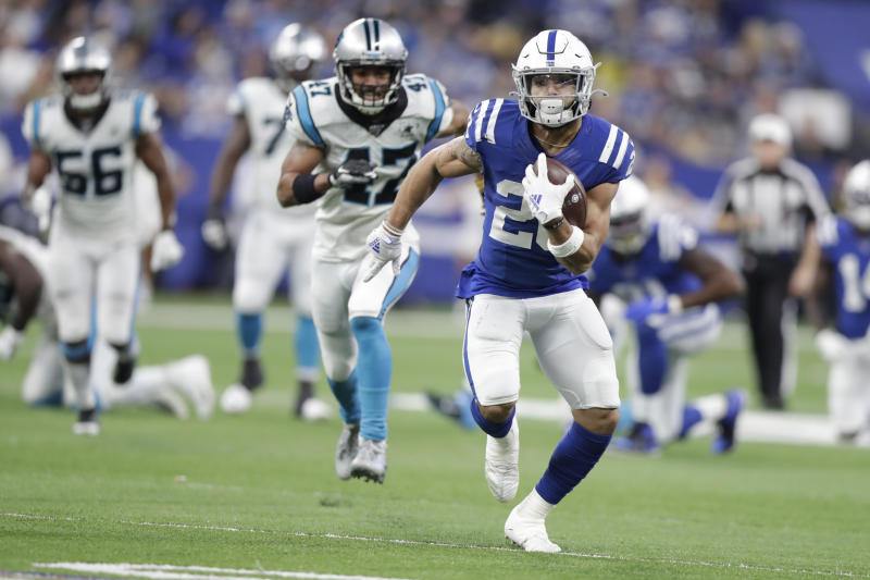 Indianapolis Colts' Jordan Wilkins (20) runs during the second half of an NFL football game against the Carolina Panthers, Sunday, Dec. 22, 2019, in Indianapolis. (AP Photo/Michael Conroy)