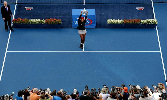"<span class=""element-image__caption"">Serena Williams of the United States celebrates with the trophy after defeating <a class=""link rapid-noclick-resp"" href=""/olympics/rio-2016/a/1110228/"" data-ylk=""slk:Caroline Wozniacki"">Caroline Wozniacki</a> of Denmark to win their women's singles final match on Day fourteen of the 2014 US Open.</span> <span class=""element-image__credit"">Photograph: Streeter Lecka/Getty Images</span>"