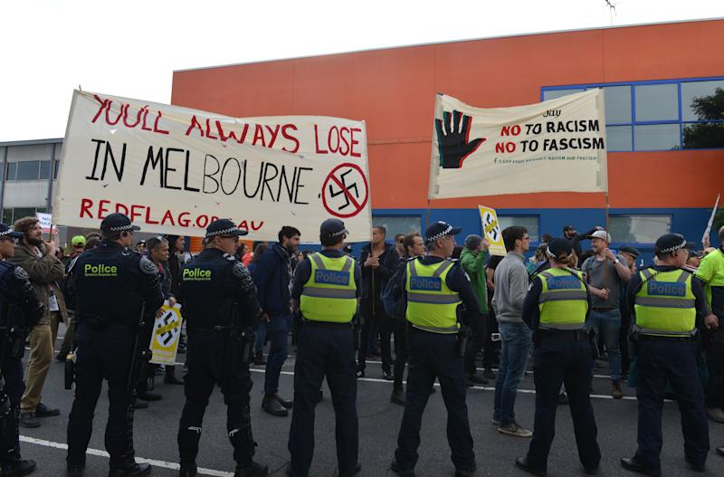 "Members of Campaign Against Racism and Fascism hold a banner reading ""You'll Always Lose In Melbourne"" including a Nazi sign crossed out during a protest in 2017."
