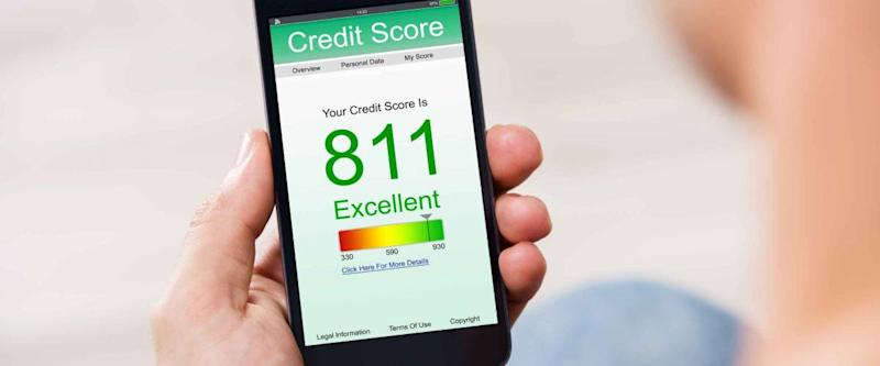 Man Holding Smart Phone Showing Credit Score Application On A Screen