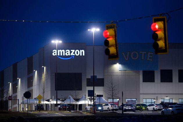 """A """"Vote"""" banner hangs at Amazon's Bessemer, Alabama, warehouse during the union election. Workers ended up voting 1,798 to 738 against unionizing. (Photo: PATRICK T. FALLON via Getty Images)"""