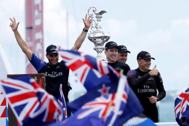 FILE PHOTO: mirates Team New Zealand celebrates with the America's Cup trophy in 2017 after defeating Oracle Team USA