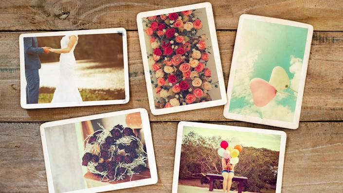 Instant photo album of remembrance and nostalgia in wedding and honeymoon on wood table.
