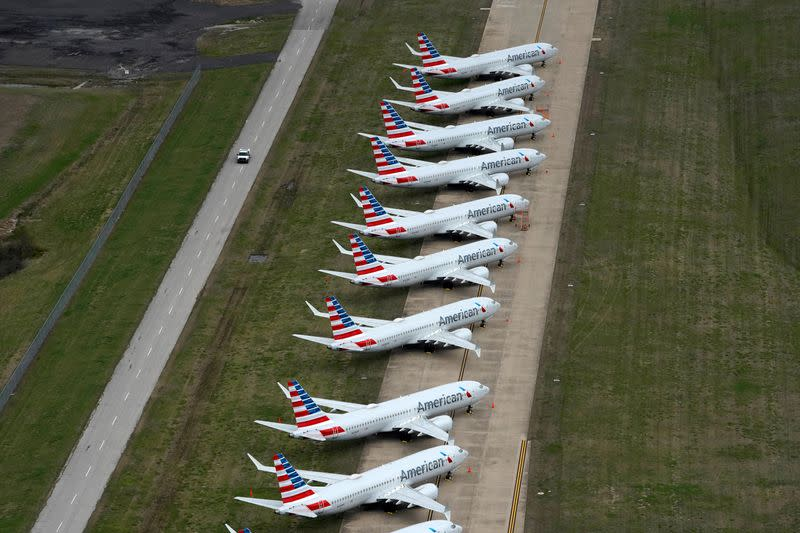 FILE PHOTO: American Airlines 737 max passenger planes are parked on the tarmac at Tulsa International Airport in Tulsa