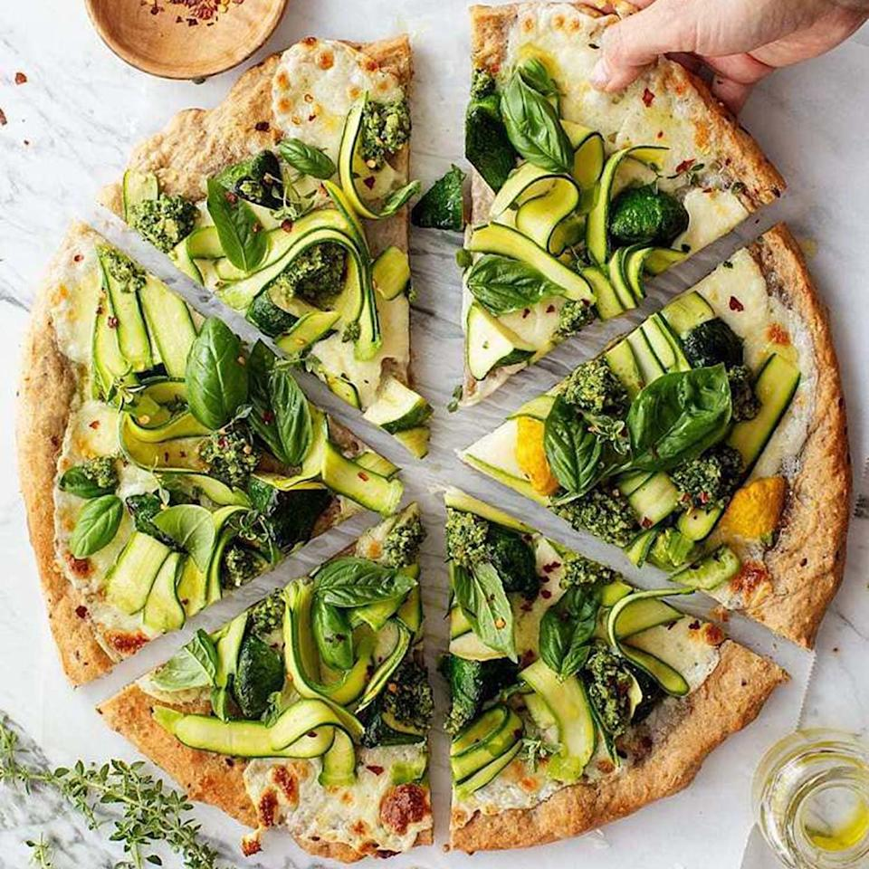 """<p>The line between vegetable pizza and salad pizza is blurred, but who cares when it tastes this good? If nothing else, the rule seems to be that salad pizza is any pie that has raw, fresh produce on top, which puts this zucchini pizza squarely in that category. It's a cheese pizza topped with zucchini ribbons, thyme, and pesto, so pretty much yum.</p> <p><strong>Get the recipe:</strong> <a rel=""""nofollow"""" href=""""https://www.loveandlemons.com/herb-garden-zucchini-pizza/"""">Herb Garden Zucchini Pizza</a></p>"""