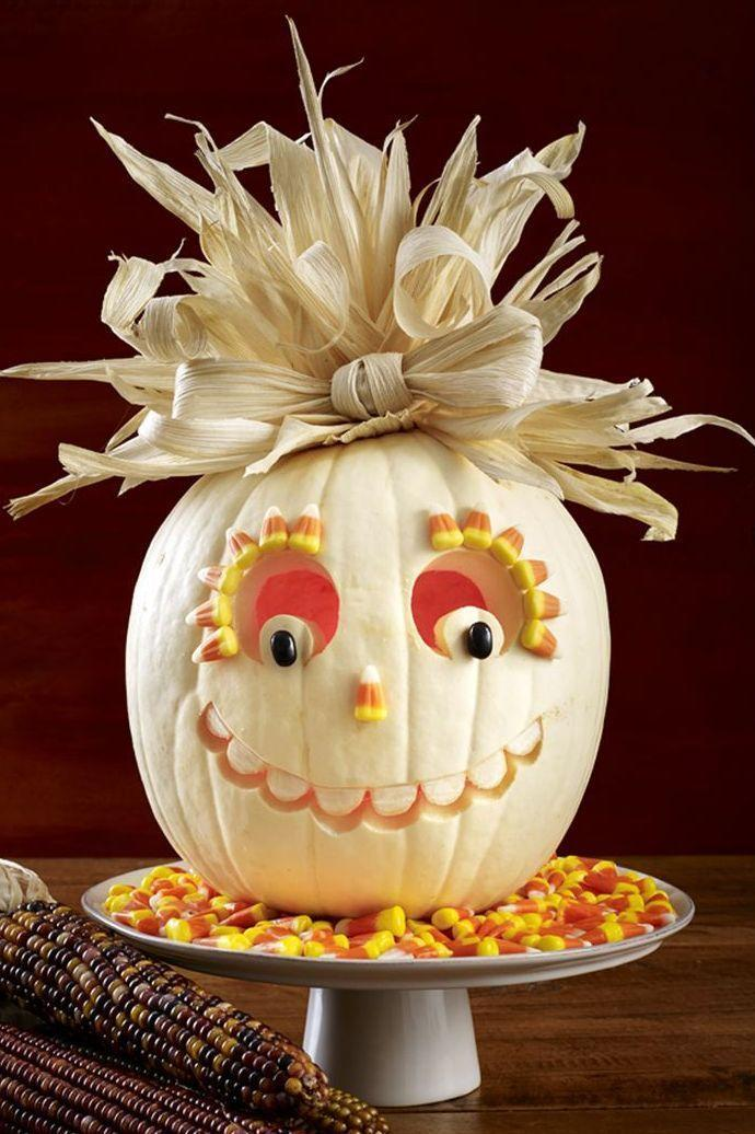 <p>This candy-filled scarecrow is way too sweet to scare away any trick-or-treaters. Follow a classic pumpkin face design, and then make its features pop with candy corn in assorted shapes and sizes. </p>
