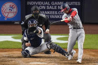 Washington Nationals' Trea Turner hits an RBI single during the eighth inning of the team's baseball game against the New York Yankees on Friday, May 7, 2021, in New York. (AP Photo/Frank Franklin II)