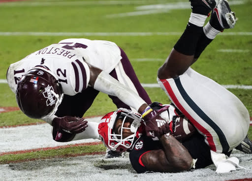 Georgia wide receiver Kearis Jackson scores a touchdown next to Mississippi State safety Shawn Preston Jr. (12) during the second half of an NCAA college football game Saturday, Nov. 21, 2020, in Athens, Ga. (AP Photo/Brynn Anderson)