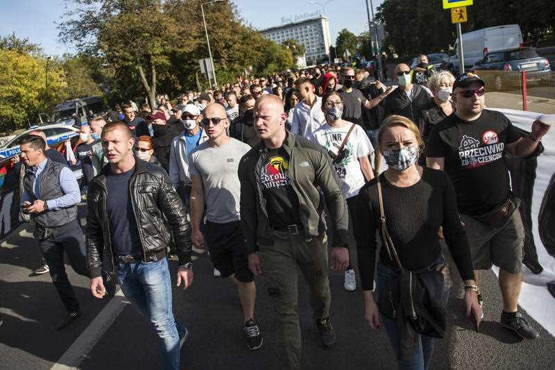 "Activists shouting slogans during the march. People took part in the ""March of Normality"" organised by the National-Radical Camp (ONR) and the Autonomic Nationalists of Bialystok."