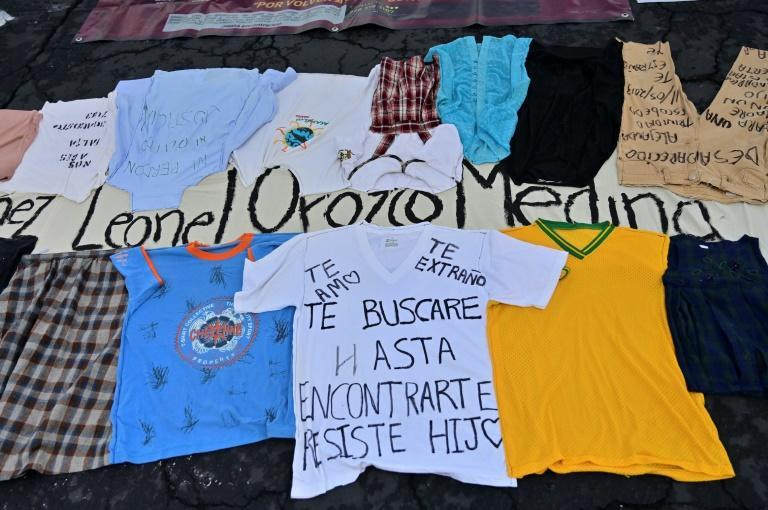 Families brought clothes of their missing loved ones to the demonstration (AFP/PEDRO PARDO)
