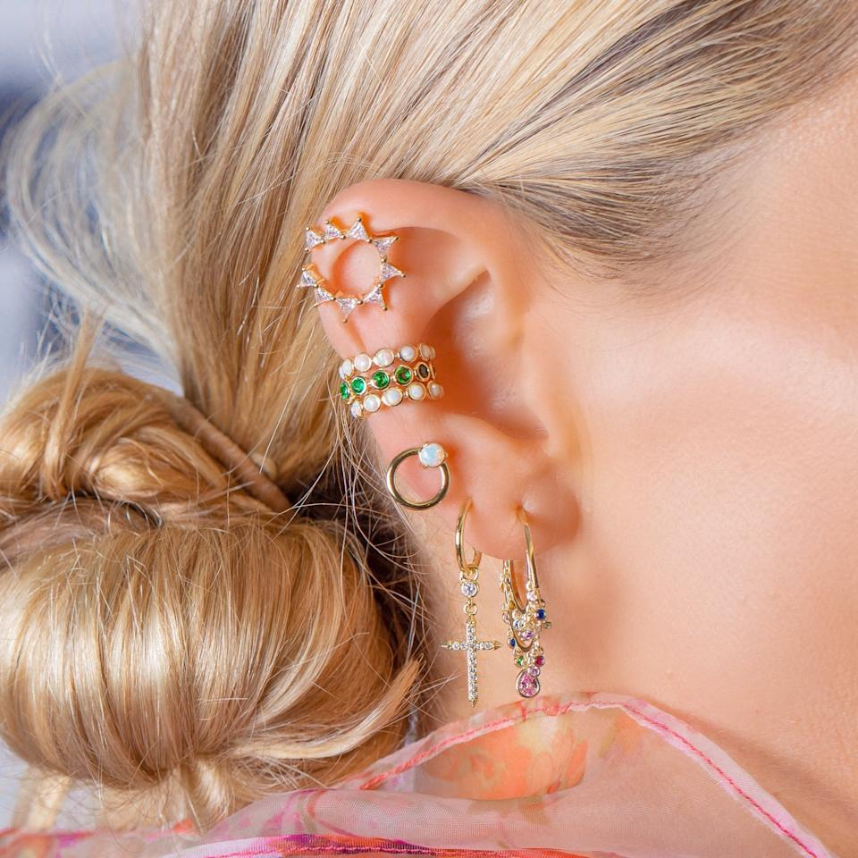"""<p>This cool <a href=""""https://www.popsugar.com/buy/Melinda-Maria-Reese-Earcuff-548022?p_name=Melinda%20Maria%20Reese%20Earcuff&retailer=melindamaria.com&pid=548022&price=45&evar1=fab%3Auk&evar9=47204219&evar98=https%3A%2F%2Fwww.popsugar.com%2Ffashion%2Fphoto-gallery%2F47204219%2Fimage%2F47204411%2FMelinda-Maria-Reese-Earcuff&list1=shopping%2Cjewelry%2Caccessories%2Cearrings%2Cfashion%20shopping%2Cmelinda%20maria&prop13=api&pdata=1"""" rel=""""nofollow"""" data-shoppable-link=""""1"""" target=""""_blank"""" class=""""ga-track"""" data-ga-category=""""Related"""" data-ga-label=""""https://melindamaria.com/collections/earrings/products/reese-ear-cuff"""" data-ga-action=""""In-Line Links"""">Melinda Maria Reese Earcuff</a> ($45) looks like the sun, and we've never seen anything quite like it.</p>"""