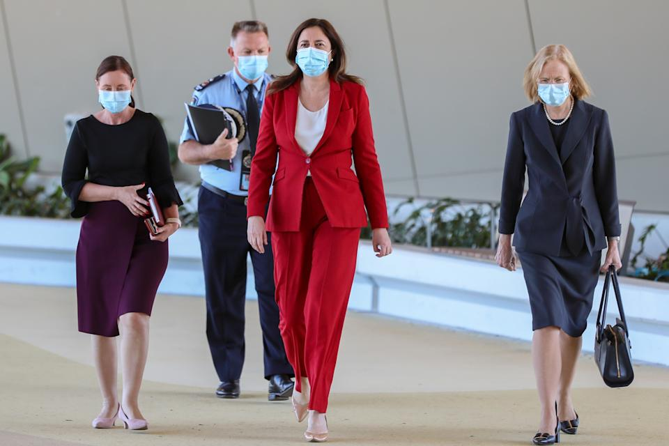Queensland Police Acting Deputy Commissioner Shane Chelepy, Queensland Premier Annastacia Palaszczuk and Queensland Chief Health Officer Dr Jeannette Young arrive to a press conference. Source:AAP