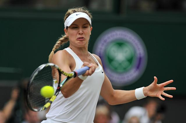 Canada's Eugenie Bouchard returns to Czech Republic's Petra Kvitova during the women's final on day twelve of Wimbledon Championships at The All England Tennis Club in southwest London, on July 5, 2014 (AFP Photo/Glyn Kirk)