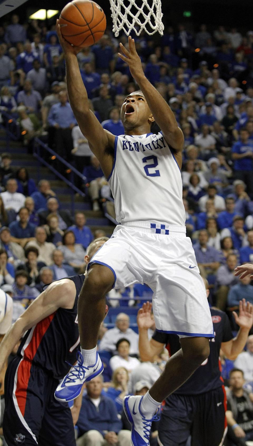 Kentucky's Aaron Harrison (2) shoots in front of Belmont's Drew Windler, left, during the second half of an NCAA college basketball game, Saturday, Dec. 21, 2013, in Lexington, Ky. Kentucky won 93-80. (AP Photo/James Crisp)