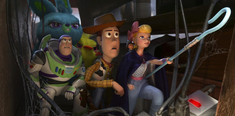 """This image released by Disney shows, foreground from left, Buzz Lightyear, voiced by Tim Allen, Woody, voiced by Tom Hanks  and Bo Peep, voiced by Annie Potts in a scene from """"Toy Story 4."""" On Monday, Dec. 9, 2019, the film was nominated for a Golden Globe for best animated film. (Disney/Pixar via AP)"""