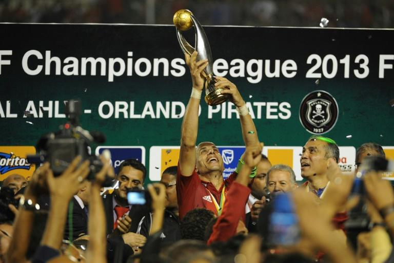 Egypt legend Wael Gomaa lifts the CAF Champions League trophy after Al Ahly won the 2013 final