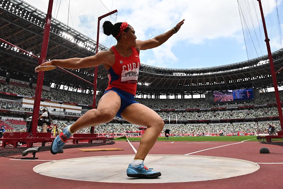 <p>Cuba's Yaime Perez competes in the women's discus throw qualification during the Tokyo 2020 Olympic Games at the Olympic Stadium in Tokyo on July 31, 2021. (Photo by Andrej ISAKOVIC / AFP)</p>