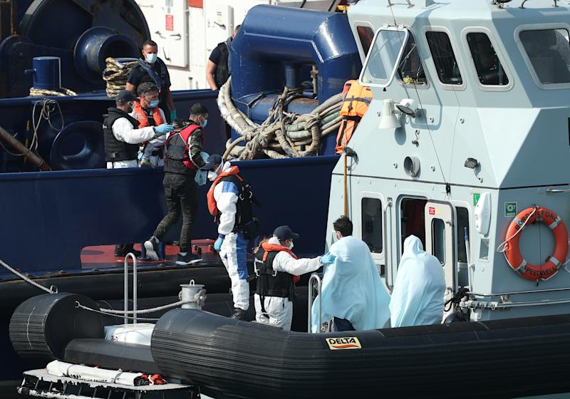 A Border Force vessel brings a group of people thought to be migrants into Dover, Kent, following a number of small boat incidents in The Channel.