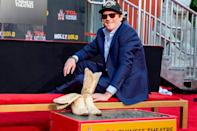 <p>Michael Madsen places his boots in the cement during his Hand and Footprint ceremony at the TCL Chinese Theatre in Hollywood on Monday. </p>