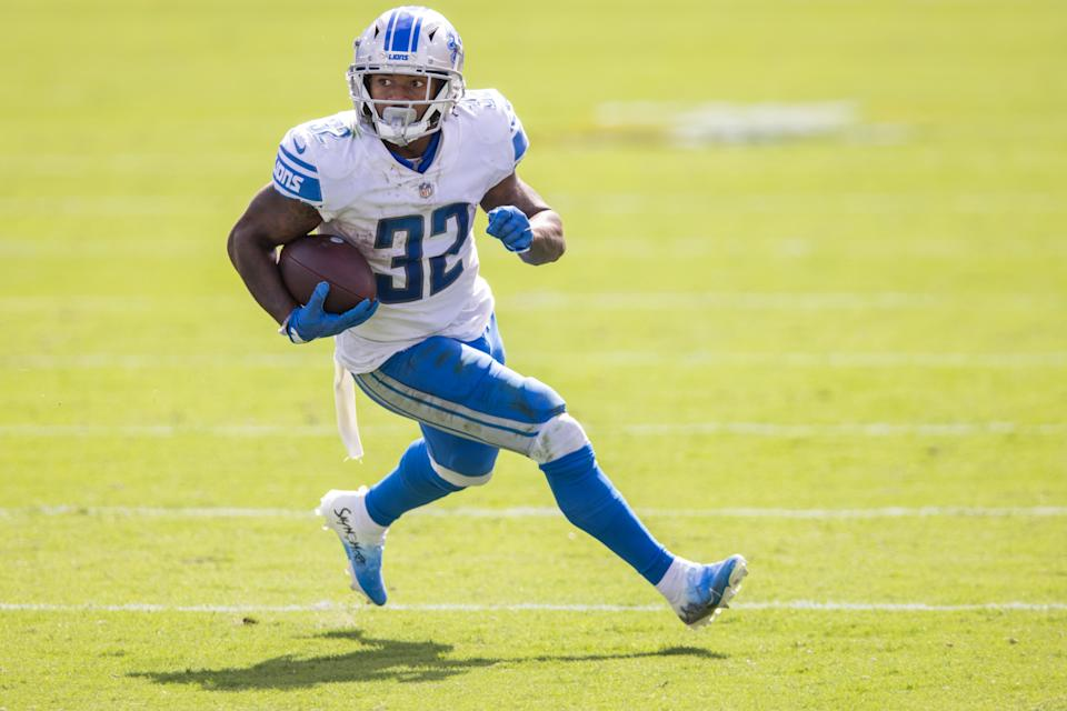 JACKSONVILLE, FLORIDA - OCTOBER 18: D'Andre Swift #32 of the Detroit Lions runs for yardage against the Jacksonville Jaguars defense during the first half of a game at TIAA Bank Field on October 18, 2020 in Jacksonville, Florida. (Photo by James Gilbert/Getty Images)