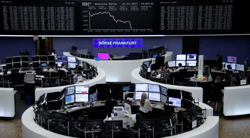 Traders work in front of the German share price index, DAX board, at the stock exchange in Frankfurt, Germany, July 21, 2017. REUTERS/Staff/Remote