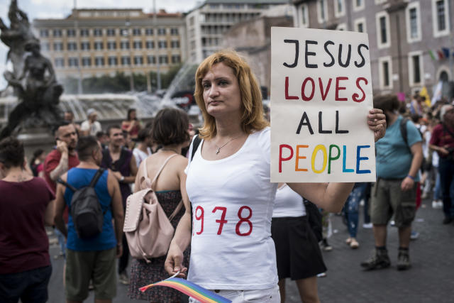<p>People take part in the annual gay pride parade in downtown Rome on June 9, 2018. Thousands of people paraded noisily on floats through the historic streets of Rome to celebrate Gay Pride. (Photo: Jacopo Landi/NurPhoto via Getty Images) </p>