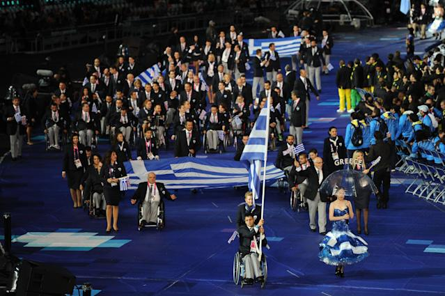 LONDON, ENGLAND - AUGUST 29: Swimmer Christos Tampaxis of Greece carries the flag during the Opening Ceremony of the London 2012 Paralympics at the Olympic Stadium on August 29, 2012 in London, England. (Photo by Gareth Copley/Getty Images)