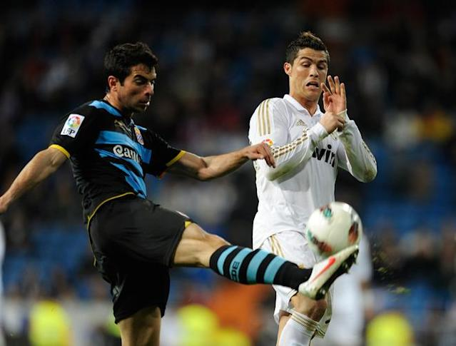 Real Madrid's Portuguese forward Cristiano Ronaldo (R) fights for the ball with Espanyol's defender Jordi Amat Maas on March 4, 2012 during a Spanish league football match at the Santiago Bernabeu stadium in Madrid. (Photo by Dani Pozo /AFP/Getty Images)