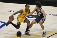 San Francisco's Jamaree Bouyea, left, is guarded by Virginia's Kihei Clark, right, in the second half of an NCAA college basketball game, Friday, Nov. 27, 2020, in Uncasville, Conn. (AP Photo/Jessica Hill)
