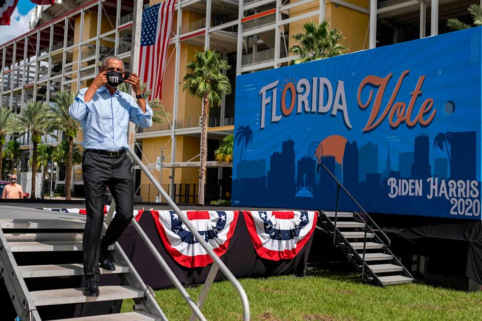 Former President Barack Obama leaves the stage after speaking at a drive-in rally for his former vice president, Democratic nominee Joe Biden, in Orlando, Florida on October 27, 2020.