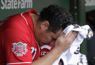 Cincinnati Reds relief pitcher David Hernandez wipes his face in the dugout during the seventh inning of a baseball game against the Chicago Cubs in Chicago, Wednesday, July 17, 2019. (AP Photo/Nam Y. Huh)