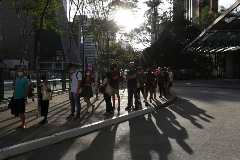 Crowds of shoppers head to Brazil malls reopening in big cities at heart of pandemic