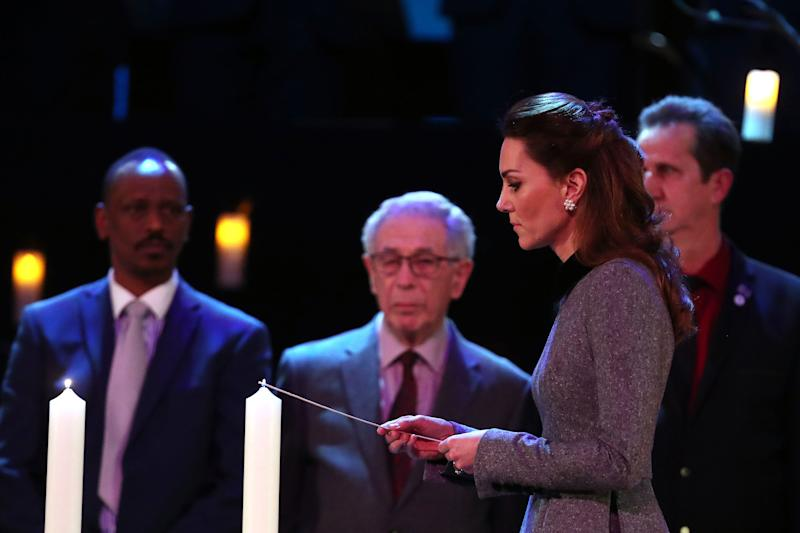 Britain's Catherine, Duchess of Cambridge lights a candle during the UK Holocaust Memorial Day Commemorative Ceremony at Methodist Central Hall in London on January 27, 2020. - Holocaust Memorial Day takes place each year on the 27th January, the anniversary of the liberation of Auschwitz-Birkenau, and honours survivors of the Holocaust, Nazi Persecution, and subsequent genocides in Cambodia, Rwanda, Bosnia and Darfur. 2020 marks the 75th anniversary of the liberation of Auschwitz-Birkenau.