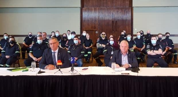 NAPE president Jerry Earle, centre left, was joined by about 30 paramedics during a press conference in St. John's on Thursday. (Henrike Wilhelm/CBC - image credit)