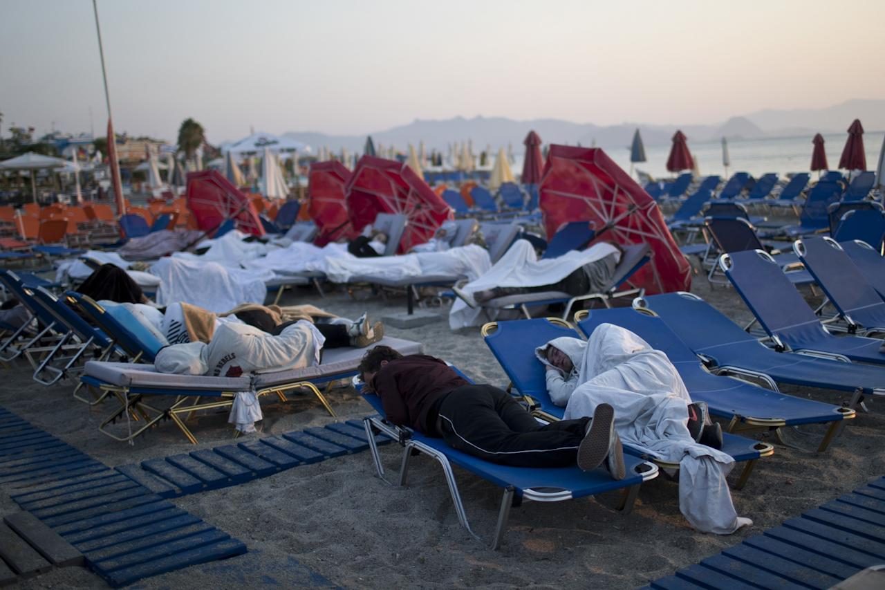 <p>Tourist sleep on sun beds at a beach of the Greek island of Kos, on Saturday, July 22, 2017. Hundreds of residents and tourists on the eastern Greek island of Kos spent the night sleeping outdoors, on beach lounge-chairs, in parks and olive groves or in their cars, a night after a powerful earthquake killed two tourists and injured nearly 500 others across the Aegean Sea region, in Greece and Turkey. <br /><br />Source: Associated Press </p>