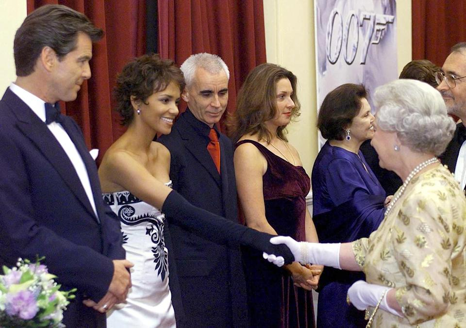 <p>In 2002, Queen Elizabeth met with <em>Die Another Day </em>stars Pierce Brosnan (who played Bond at the time) and Halle Berry at the film's world premiere. </p>