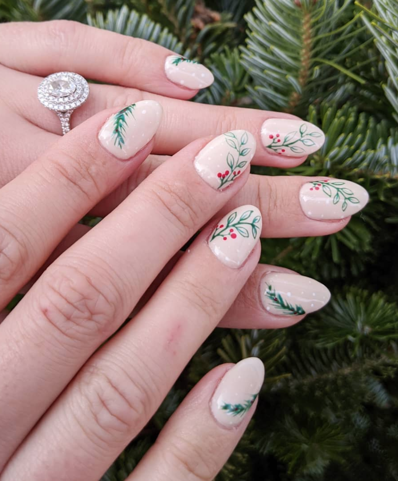 "<p>If you're a neutral nails all year long type, take your cue from <a href=""https://www.instagram.com/nailsbykassie/"" rel=""nofollow noopener"" target=""_blank"" data-ylk=""slk:Jones"" class=""link rapid-noclick-resp"">Jones</a>, who added in a bit of Christmas greenery over a blush pink base to create a chic yet subtle manicure.</p><p><a class=""link rapid-noclick-resp"" href=""https://go.redirectingat.com?id=74968X1596630&url=https%3A%2F%2Fwww.etsy.com%2Flisting%2F845021487%2Fglitter-nail-polish-strips-christmas&sref=https%3A%2F%2Fwww.oprahmag.com%2Fbeauty%2Fg34113691%2Fchristmas-nail-ideas%2F"" rel=""nofollow noopener"" target=""_blank"" data-ylk=""slk:SHOP NAIL STRIPS"">SHOP NAIL STRIPS</a></p>"