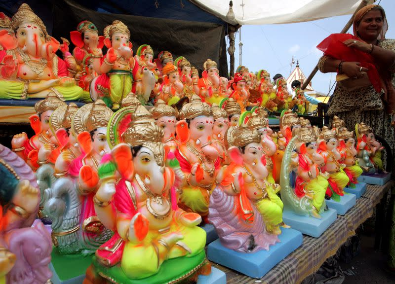 FILE PHOTO: A devotee buys an idol of Hindu elephant God Lord Ganesha in Ahmedabad