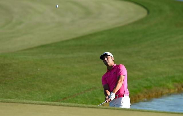 Jon Rahm of Spain chips onto the 18th green during the second round of the Shell Houston Open at the Golf Club of Houston on March 31, 2017 in Humble, Texas (AFP Photo/Josh Hedges)
