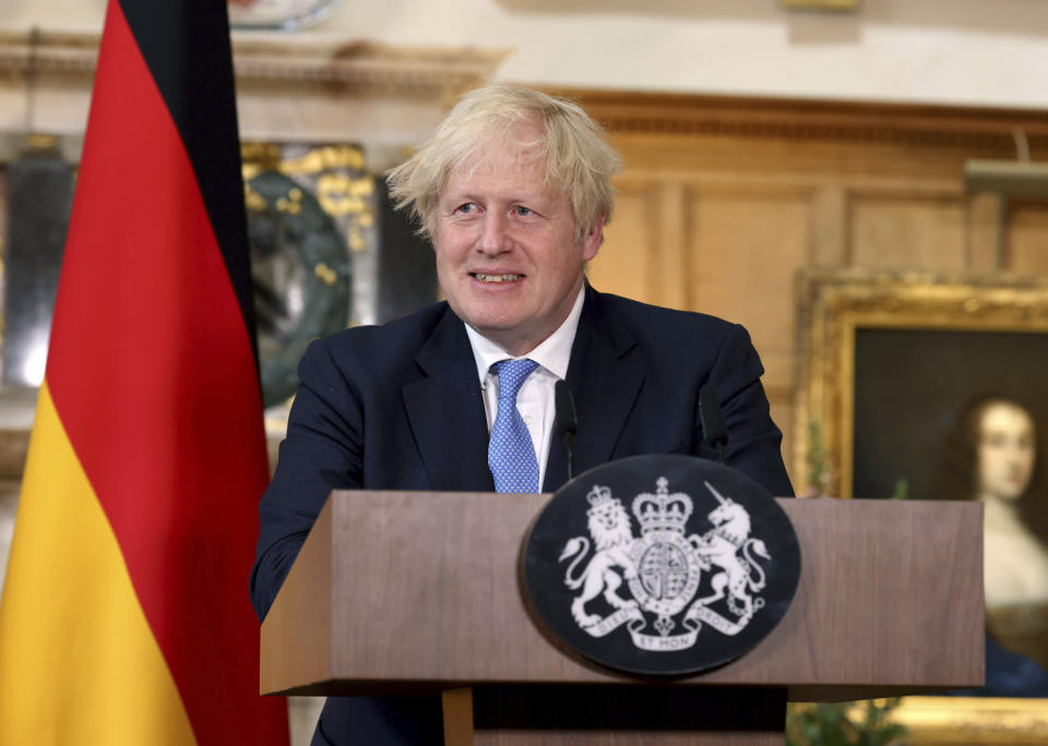 Britain's Prime Minister Boris Johnson takes part in a press conference with German Chancellor Angela Merkel, after their meeting at Chequers, the country house of the Prime Minister, in Buckinghamshire, England, Friday July 2, 2021. Johnson is likely to push Angela Merkel to drop her efforts to impose COVID-19 restrictions on British travelers as the German chancellor makes her final visit to Britain before stepping down in the coming months. Johnson will hold talks with Merkel at his country residence on Friday. (Jonathan Buckmaster//Pool Photo via AP)