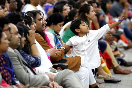 """A boy reacts during the """"Howdy Modi"""" event in Houston"""