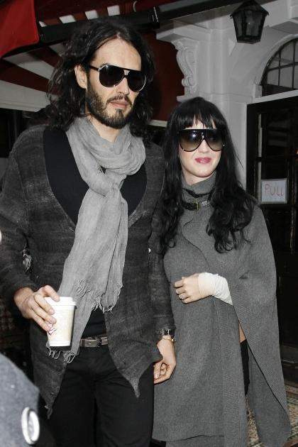 Russell Brand and Katy Perry, in happier times, show off a similar grey wardrobe in London, England on January 10, 2010  -- Getty Premium